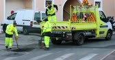 Roquebrune-Cap-Martin, France - December 5, 2018: Workmen Repairing Road Surface Damaged By Weather And Traffic, Industry And Teamwork - DCi 4K Video