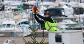 Menton, France - December 7, 2018: Worker On The Crane Install And Decorate The Christmas Tree, Decoration Of A Large Christmas Tree With The Port Of Menton In The Background, French Riviera, Europe - DCi 4K Resolution