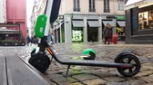 electric scooters : Lyon, France - January 4, 2019: Two Lime-S Electric Rental Scooter Parked In Merciere Street Street In Lyon, France, Europe - 4K Resolution