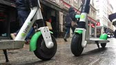 lambreta : Lyon, France - January 4, 2019: Two Lime-S Electric Rental Scooter Parked In Merciere Street Street In Lyon, France, Europe - 4K Resolution