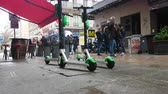 paryż : Lyon, France - January 4, 2019: Four Lime-S Electric Rental Scooter Parked In Merciere Street Street In Lyon, France, Europe - 4K Resolution Wideo