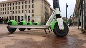 parked : Lyon, France - January 4, 2019: Four Lime-S Electric Rental Scooter Parked On Place Bellecour In Lyon, France, Europe - 4K Resolution Stock Footage