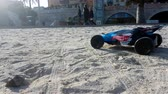 sofőr : Menton, France - January 13, 2019: Radio Controlled Hot Wheels RC Gator Buggy. Off Road Buggy On The Beach Sand In Menton France On The French Riviera, Europe - 4K Resolution