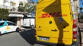 Monte-Carlo, Monaco - January 25, 2019: Yellow Mercedes-Benz Sprinter DHL Truck Delivery Delivery In The Street Of Monaco. French Riviera, Europe - 4K Video