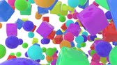 Colorful bouncing shapes, spheres & boxes float or flying around. Good for video introduction, title or text background, footage transitions. 3D rendered animation. Стоковые видеозаписи
