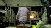 article : MURANO, ITALY - APRIL 26: Glassmaker in action in the Murano furnace on April 26, 2014