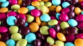 short film : Sugar coated chocolate candy candies colorful background.