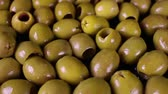 close up : Olive texture. Olives as background. Shiny green olives. Olive wallpaper pattern texture.