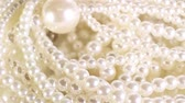 White pearl perarls as background. Jewel,jewelry. Vídeos
