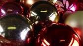 hirdetés : Christmas ornaments rotating closeup texture pattern background Stock mozgókép