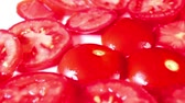 Tomato slices rotating closeup texture pattern background