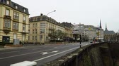 franklin : Luxembourg City, Luxembourg - winter 2016. Panning from Passerelle bridge to Boulevard Franklin Delano Roosevelt. This is a major arterial road before Monument du souvenir. Stock Footage