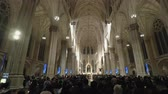 contemporâneo : New York, USA St. Patricks Cathedral with people during mass. Inside The Cathedral of St. Patrick, a Neo-Gothic Roman Catholic church between 50th and 51st Streets Manhattan. Stock Footage