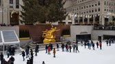 korcsolyázás : New York City Rockefeller Center ice skating. Day view of The Rink at Rockefeller Center with crowd.