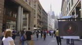 şehir merkezinde : Milan, Italy Corso Vittorio Emanuele II street with crowd. Day view of pedestrian area of fashion street stores in Milano. Duomo church visible in the background. Stok Video