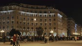 yunan : Thessaloniki, Greece Aristotelous square at night, in 4K.  Night view of crowd at city main square, with traditional architecture.