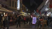 yunan : Thessaloniki, Greece Ladadika district crowd at restaurants at night. Night view of much visited city area with local bars and tavernas, Ladadika means the shops that sell oil & its derivatives. Stok Video