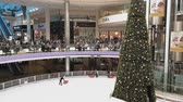 chipre : My Mall Limassol, Cyprus Christmas 2018 Decorations with skating ice rink. Internal seasonal view of festive details with Christmas tree at shops and areas of large mall.