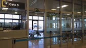 maltês : Malta International Airport MLA gates. Empty boarding area with passengers seats next to the departure gates of the Maltese airport. Vídeos