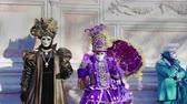 finomság : Venice, Italy Carnival mask and costume poses in Campo San Zaccaria. Masked persons in traditional costume pose at a Venetian square during the Venice 2019 Carnival.