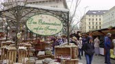yerleri : Vienna, Austria Easter Market Altwiener Freyung Ostermarkt. Crowd at Wien, Osterreich 2019 street market, where local vendors from Austrian regions sell decorative Easter eggs, food & drinks. Stok Video