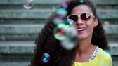 Joyful woman with soap bubbles