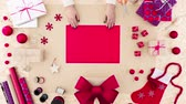 Video of woman of packaging Christmas presents and gifts Stock Footage