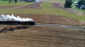 vapor : Steam Passenger Train Puffing Smoke Along Amish Countryside as Seen by a Drone