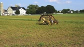 pensilvanya : Old Amish Farm Equipment Seating in the Field