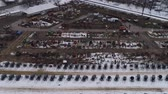 brochura : Aerial View of Getting Ready for an Amish Winter Mud Sale Stock Footage