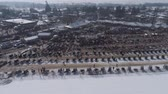 leilão : Aerial View of an Amish Winter Mud Sale in the Mud Vídeos