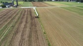 pensilvanya : Aerial View of Amish Farmer Seeding His Field with 6 Horses Stok Video