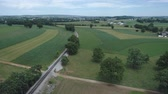 ペンシルベニア州 : Aerial View of Amish Farm Land by Rail Road Track 動画素材