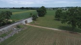 pensilvanya : Aerial View of Amish Farm Land by Rail Road Track Stok Video