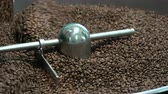 connoisseur : roasted coffee beans in a coffee roaster Stock Footage