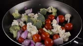 cut : Vegetables fall on the frying pan Stock Footage