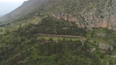 Aerial view of archaeological site of ancient Delphi, site of temple of Apollo and the Oracle, Greece Dostupné videozáznamy