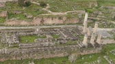 santuário : Aerial view of archaeological site of ancient Delphi, site of temple of Apollo and the Oracle, Greece Stock Footage