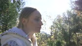 boreal : woman walks through the forest on a sunny day Stock Footage