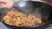 recipe : Frying chicken to make a traditional spanish paella