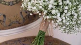 nupcial : Bridal bouquet lying on a vintage chair close-up Stock Footage