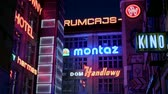 yönlü : Retro Neon signs in polish language night city