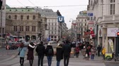 viena : City center old town with shops and restaurants full of people with christmas decorations lights cars horses at day time in Vienna Austria December 2018
