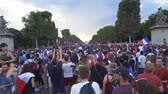 police france : Crowd on the Champs Elysees Avenue in Paris in France after the 2018 World Cup Stock Footage