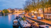 seine : The Seine river with boats at night with lights on, zoom in Stock Footage