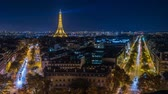 pontes : Illuminated Eiffel tower at night seen from the Arc de Triomphe in Paris, zoom in Stock Footage
