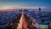 la defense : La defense Arch and business district in Paris seen from the Arc de triomphe at sunset, zoom in