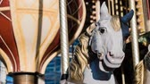 saddle : White horse with yellow saddle on a french merry-go-round, zoom in