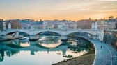 Рим : Sunset over the Tiber river in Rome in the winter, zoom in