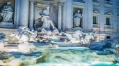 noc : Trevi fountain in Rome by night with lights on, zoom in